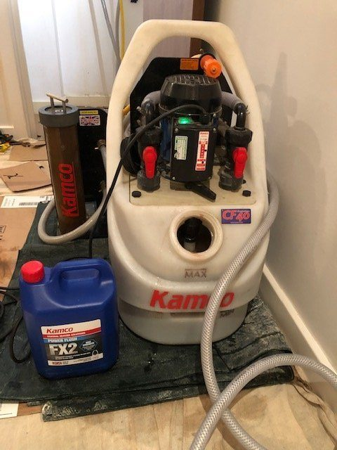 during - Power flush of system plus installation of condensation pipe