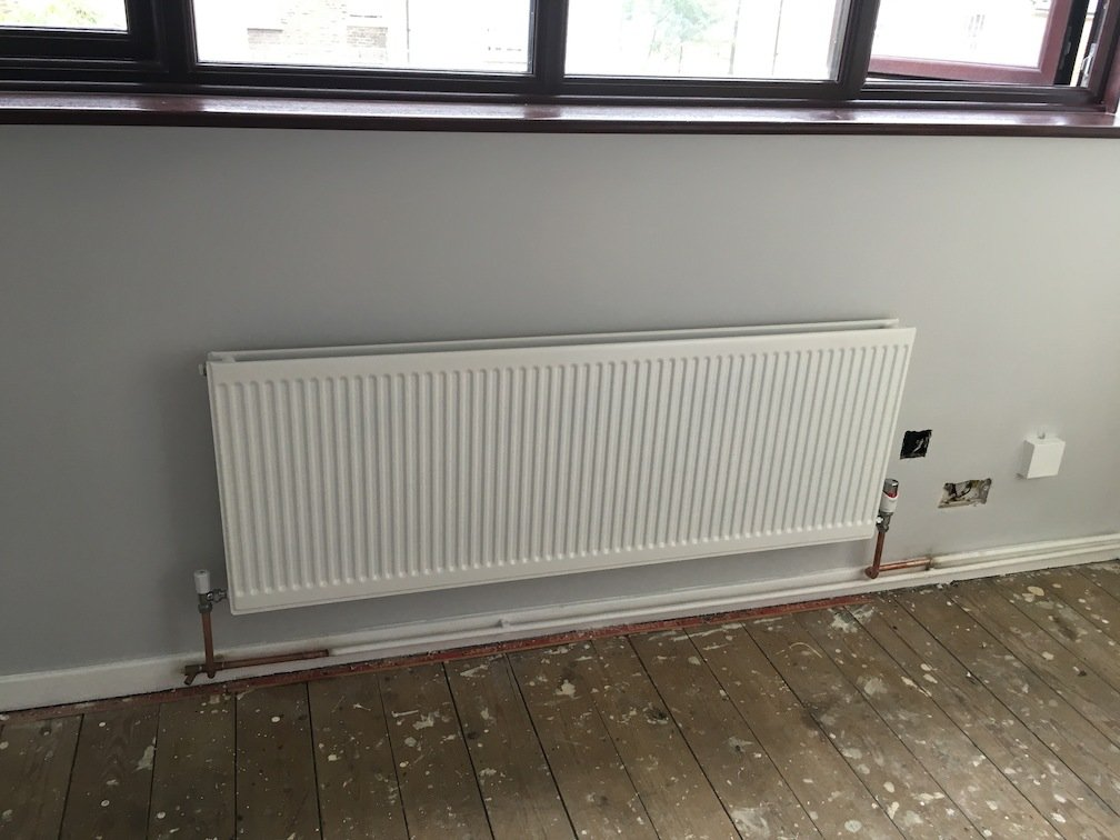 after - Installed new radiator and serviced existing boiler