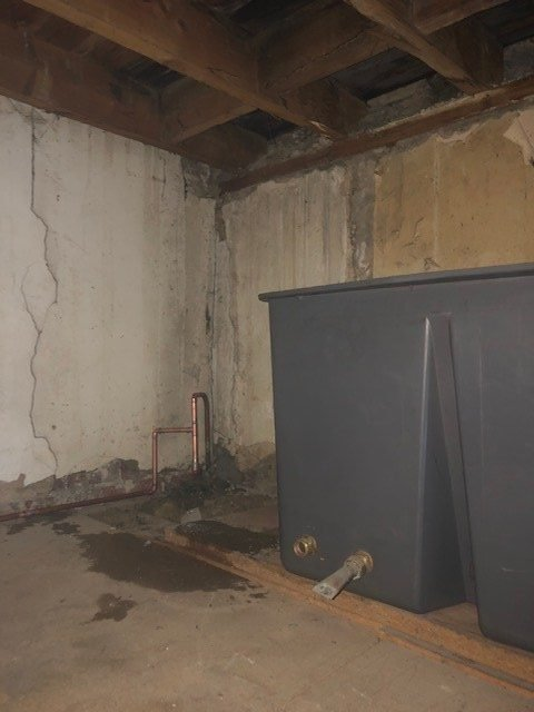 during - Loft Water Tank Removal